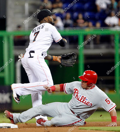 Carlos Ruiz, Jose Reyes Philadelphia Phillies' Carlos Ruiz (51) is out at second base on a fielder's choice hit by Domonic Brown as Miami Marlins shortstop Jose Reyes (7) throws to first base in the second inning of a baseball game in Miami, . Brown was safe at first base