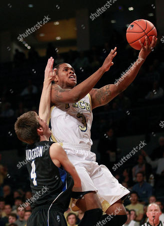 Marcus Georges Hunt, Austin Anderson Georgia Tech's Marcus Georges-Hunt (3) is fouled by Presbyterian guard Austin Anderson (4) as he drives to the basket in the first half of an NCAA college basketball game, in Atlanta