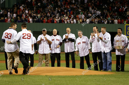 Jason Varitek, Keith Foulke, Demarlo Hale, Brad Mills, Terry Francona, Dave Wallace, Tim Wakefield, Mike Timlin, Pedro Martinez 2004 World Championship Boston Red Sox, from left, Jason Varitek (33), Keith Foulke (29), coach Demarlo Hale, coach Brad Mills, manager Terry Francona, coach Dave Wallace, and pitchers Tim Wakefield, Mike Timlin, and Pedro Martinez applaud on the mound during ceremonies honoring the team prior to a baseball game against the Tampa Bay Rays at Fenway Park in Boston
