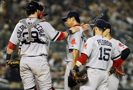 Bpbby Valentine, Jarrod Saltalamacchia, Dustin Pedroia Boston Red Sox manager Bobby Valentine, obscured left, and catcher Jarrod Saltalamacchia (39) console starting pitcher Daisuke Matsuzaka, center, before Matsuzaka was pulled during the third inning of their baseball game against the New York Yankees at Yankee Stadium in New York, . Red Sox second baseman Dustin Pedroia (15) watches