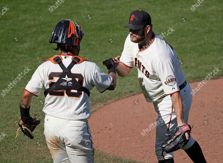 Hector Sanchez, Brad Penny San Francisco Giants relief pitcher Brad Penny, right, is greeted by catcher Hector Sanchez, left, at the end of a baseball game against the Colorado Rockies in San Francisco, . San Francisco won 9-2