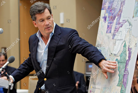 Louis Bacon Billionaire hedge fund manager Louis Bacon uses a map to show his ranch in southern Colorado during a news conference in Denver on . Secretary of Interior Ken Salazar announced at the conference that Bacon is adding a conservation easement to protect nearly 77,000 acres of his 81,400-acre Trinchera Ranch from development