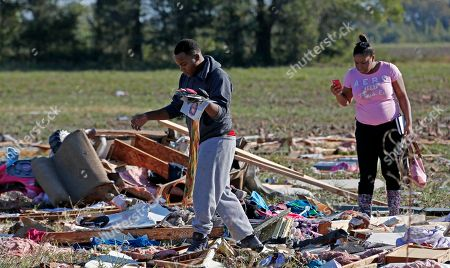 Stock Image of Coleman Jenkins, Carlisa Cooper Coleman Jenkins, Gladys Berry's son, left, and cousin Carlisa Cooper rummage through the remains of Berry's mobile home in Anguilla, Miss., following a night and early morning of severe weather that destroyed several homes in this Delta community and sent some of its residents to area hospitals
