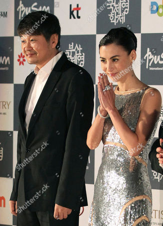 Cecilia Cheung, Hur Jin-ho Hong Kong actress Cecilia Cheung and South Korean director Hur Jin-ho pose during the opening ceremony of the Busan International Film Festival in Busan, South Korea