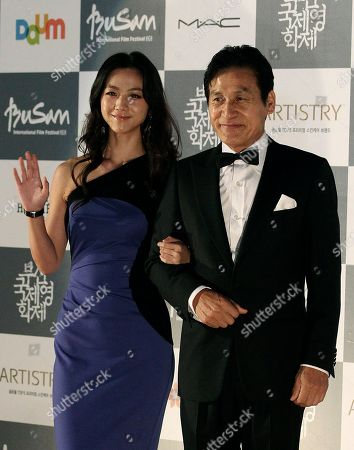 Tang Wei, Ahn Sung-ki Chinese actress Tang Wei and South Korean actor Ahn Sung-ki pose during the opening ceremony of the Busan International Film Festival in Busan, South Korea