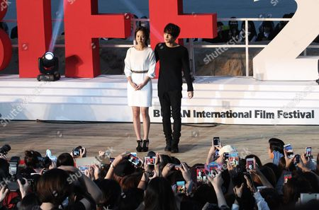 """Stock Picture of Kim Jaejoong, Song Ji-hyo South Korean singer and actor Kim Jaejoong and actress Song Ji-hyo pose at an event to promote their move """"Code Name: Jackal"""" during the Busan International Film Festival in Busan, South Korea"""