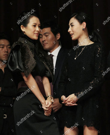 "Cecilia Cheung, Zhang Ziyi Hong Kong actress Cecilia Cheung, right, talks with Chinese actress Zhang Ziyi as they wait for a press conference to promote their movie ""Dangerous Liasons"" at Haneulyeon Theater during the Busan International Film Festival in Busan, South Korea"