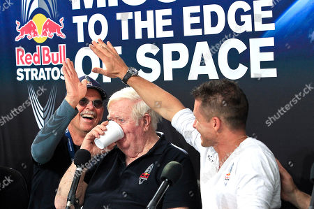 Felix Baumgartner, Mike Todd, Joe Kittinger Felix Baumgartner, right, of Austria, gives a high-five to Mike Todd, left, project life support engineer, as Col. Joe Kittinger, USAF retired and who held the previous jump ascent record at 102,799 feet, takes a drink of water, during a news conference held after Baumgartner successfully jumped from a space capsule lifted by a helium balloon at a height of just over 128,000 feet above the Earth's surface, in Roswell, N.M