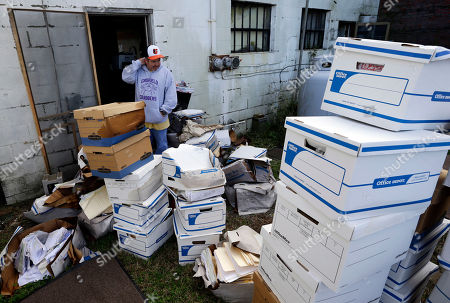 John Sterling Certified Public Accountant John Sterling looks at damaged boxes of records removed from his office after superstorm Sandy, in Crisfield, Md. Most of the records were old and on their way to the shredder he said