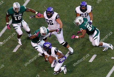 Stock Photo of Trevone Boykin, Gary Mason Jr. Terrance Lloyd, Chris McAllister, Blaize Foltz, Aviante Collins TCU quarterback Trevone Boykin (2) is pressured out of the pocket by Gary Mason Jr. (10), Terrance Lloyd (11) and Chris McAllister (31) as TCU's Blaize Foltz (66), and Aviante Collins (69) help against pressure in the first half of an NCAA college football game, in Waco, Texas