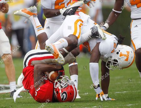 Malcolm Mitchell, Eric Gordan Georgia's Malcolm Mitchell (26) is tackled by Tennessee's Eric Gordon (24) as he fields a punt in the first half of an NCAA college football game in Athens, Ga., on