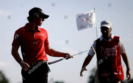 Rory McIlroy, JP Fitzgerald Rory McIlroy, left, of Northern Ireland, hands his club off to caddie JP Fitzgerald after sinking a putt on the 17th hole during the third round of the Tour Championship golf tournament, in Atlanta