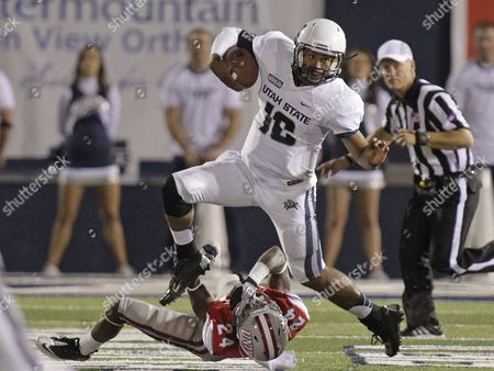 Chuckie Keeton Utah State quarterback Chuckie Keeton (16) hurdles UNLV defensive back Fred Wilson (24) in the fourth quarter of an NCAA college football game, in Logan, Utah. Utah State defeated UNLV 35-13