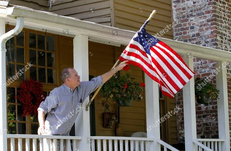 Harry Donahue Shows Virginia voter Harry Donahue adjusting an American flag on the front porch of his farmhouse, built in the 1700's, in Farmville, Va. Donahue, a 68-year-old retired chemical worker from Philadelphia's New Jersey suburbs, moved to Virginia in 2001 and brought with him an independent streak and a voting pattern that ranges from Ronald Reagan to Ross Perot. He plans to back Obama this year after supporting John McCain in 2008