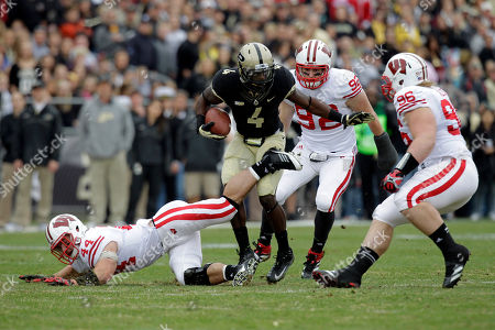 O.J. Ross, Chris Borland, Pat Muldoon, Beau Allen Purdue wide receiver O.J. Ross (4) tries to avoid the tackle from Wisconsin defenders, left to right, Chris Borland, Pat Muldoon, and Beau Allen during the first half of an NCAA college football game in West Lafayette, Ind