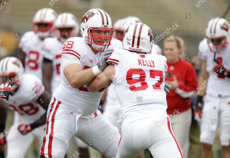 Rick Wagner, Brendan Kelly Wisconsin offensive linesman Rick Wagner, left, blocks defensive lineman Brendan Kelly before an NCAA college football game against Purdue in West Lafayette, Ind