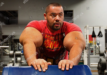 Stock Picture of Moustafa Ismail Egyptian Body builder Moustafa Ismail rests during his daily workout at World Gym in Milford, Mass. Ismail has been given the title of world's biggest arms, biceps and triceps, by the Guinness Book of World Records