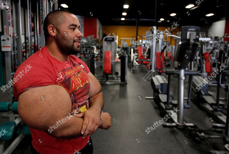 Moustafa Ismail Egyptian Body builder Moustafa Ismail pauses before beginning another routine during his daily workout at World Gym in Milford, Mass. Ismail has been given the title of world's biggest arms, biceps and triceps, by the Guinness Book of World Records