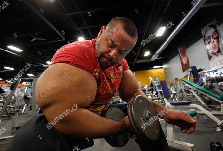 Stock Photo of Moustafa Ismail Egyptian Body builder Moustafa Ismail lifts free weights during his daily workout at World Gym in Milford, Mass. Ismail has been given the title of world's biggest arms, biceps and triceps, by the Guinness Book of World Records