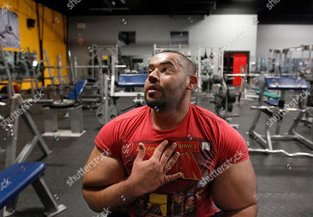 Moustafa Ismail Egyptian Body builder Moustafa Ismail takes a breather during his daily workout at World Gym in Milford, Mass. Ismail has been given the title of world's biggest arms, biceps and triceps, by the Guinness Book of World Records