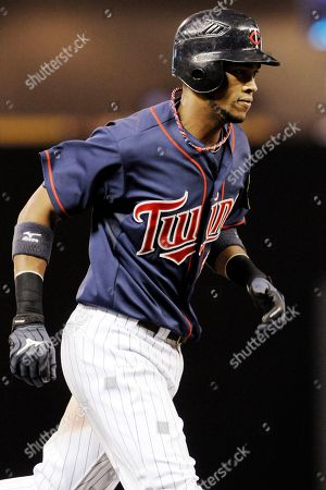 Pedro Florimon Minnesota Twins' Pedro Florimon rounds the bases after his solo home run off New York Yankees pitcher Cory Wade in the eighth inning of a baseball game, in Minneapolis. The Yankees won 6-3