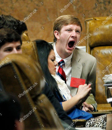 "Skyler Flowers Representative Skyler Flowers, a senior at Sumrall High School, reacts to a long morning session of debating bills with a yawn at the Mississippi Youth Legislature at the Capitol in Jackson, Miss., . About 400 high school students from throughout Mississippi are meeting at a ""legislative session"" complete with committee meetings to gain a better understanding of state government and the laws that are endorsed and produced by that body"