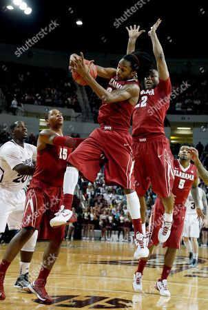 Levi Randolph, Andrew Steele, Nick Jacobs Alabama guard Levi Randolph, center, pulls down a rebound in front of guard Andrew Steele (22) and forward Nick Jacobs, left, in the first half of their NCAA college basketball game against Mississippi State in Starkville, Miss