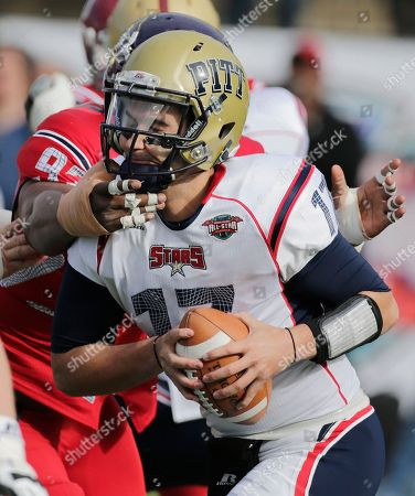 Tino Sunseri, Michael Brooks Stars quarterback Tino Sunseri (17) of Pittsburgh escapes the pressure of defender Michael Brooks (93) of East Carolina during the first half of the RayCom All-Star Football Classic football game in Montgomery, Ala