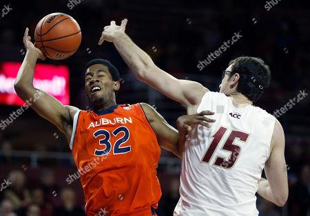 Noel Johnson, Andrew Van Nest Boston College's Andrew Van Nest (15) fouls Auburn's Noel Johnson (32) in the first half of an NCAA college basketball game in Boston