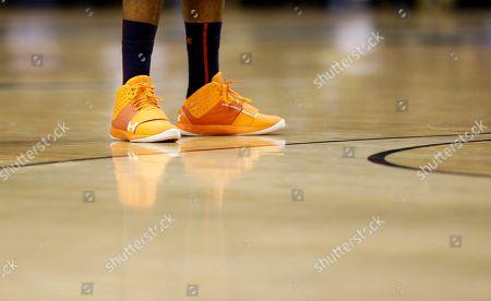 Noel Johnson The shoes of Auburn forward Noel Johnson reflect on the floor in the second half of an NCAA college basketball game against Vanderbilt, in Nashville, Tenn. Vanderbilt won 73-61