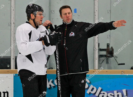 Joe Sacco, Paul Stastny Colorado Avalanche center Paul Stastny, left, confers with head coach Joe Sacco during the teams NHL hockey practice session in Englewood, Colo., on