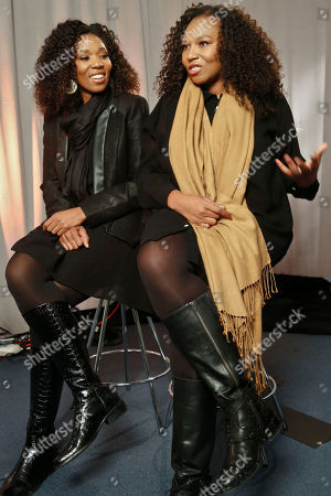 """Swati Dlamini, left, and Zaziwe Dlamini-Manaway, granddaughters of Nelson and Winnie Mandela, speak during an interview in New York. The sisters are stars of the new reality show """"Being Mandela,"""" produced by COZI TV for NBC. The 30-minute weekly show premieres on Sunday, Feb. 10 at 9 PM ET and will follow the next generation of Mandela family through the experiences of sisters Zaziwe and Swati and their families"""