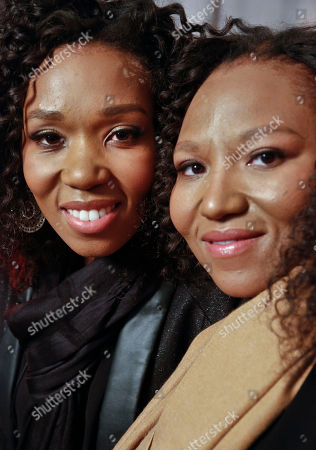 """Swati Dlamini, left, and Zaziwe Dlamini-Manaway, granddaughters of Nelson and Winnie Mandela, pose during an interview in New York. The sisters are stars of the new reality show """"Being Mandela,"""" produced by COZI TV for NBC. The 30-minute weekly show premieres on Sunday, Feb. 10 at 9 PM ET and will follow the next generation of Mandela family through the experiences of sisters Zaziwe and Swati and their families"""