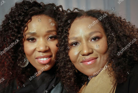 """Stock Picture of Swati Dlamini, left, and Zaziwe Dlamini-Manaway, granddaughters of Nelson and Winnie Mandela, pose during an interview in New York. The sisters are stars of the new reality show """"Being Mandela,"""" produced by COZI TV for NBC. The 30-minute weekly show premieres on Sunday, Feb. 10 at 9 PM ET and will follow the next generation of Mandela family through the experiences of sisters Zaziwe and Swati and their families"""