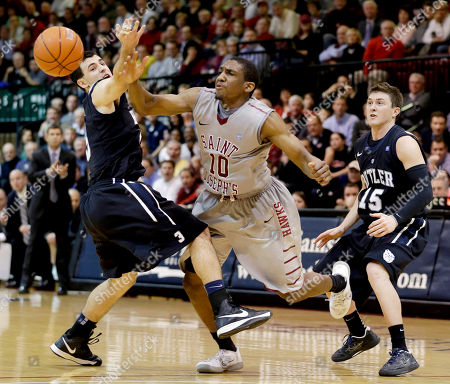 Langston Galloway, Alex Barlow, Rotnei Clarke Saint Joseph's Langston Galloway (10) loses the ball against Butler's Alex Barlow (3) and Rotnei Clarke (15) during the second half of an NCAA college basketball game, in Philadelphia. Butler won 72-66