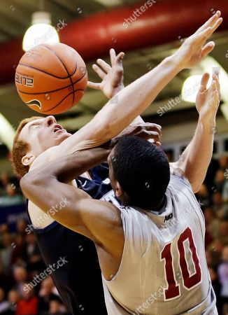 Erik Fromm, Langston Galloway Butler's Erik Fromm, left, and Saint Joseph's' Langston Galloway (10) battle for a rebound during the first half of an NCAA college basketball game, in Philadelphia