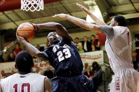 Langston Galloway, C.J. Aiken, Khyle Marshall Butler's Khyle Marshall (23) shoots between Saint Joseph's C.J. Aiken (1) and Langston Galloway (10) during the first half of an NCAA college basketball game, in Philadelphia