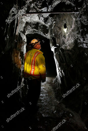 Matt Collins, chief operating officer of the Sutter Gold Mining Co., inspects one of the gold mining tunnels operated by the company near Sutter Creek, Calif. The company, which has begun mining adjacent to the historic Comet-Lincoln ore zones, announced Monday, Dec. 17, 2012, that it poured its first gold as it prepared to begin the first large scale Sierra Nevada underground gold mining in a half century