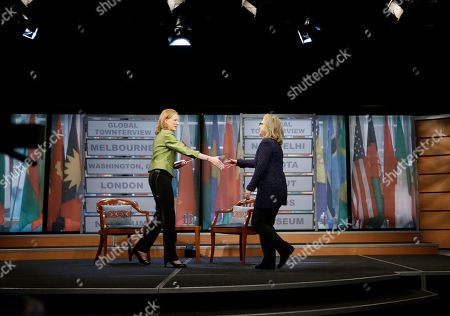 Hillary Rodham Clinton, Leigh Sales Secretary of State Hillary Rodham Clinton, right, walks on stage to greet Leigh Sales, left, Australian Broadcasting Corporation, moderator of the Global Townterview at the Newseum in Washington