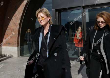 Stock Picture of Patricia Cornwell Author Patricia Cornwell leaves federal court in Boston, after she took the stand in her lawsuit against her former financial management company. Cornwell claims that the firm and a former executive cost her millions of dollars in losses or unaccounted revenue during their four-year relationship. At right is Cornwell's spouse Staci Gruber