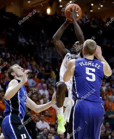 Durand Scott, Mason Plumlee Miami's Durand Scott, center, shoots against Duke's Mason Plumlee (5) and Alex Murphy (12) during the second half of an NCAA college basketball game in Coral Gables, Fla., . Miami won 90-63