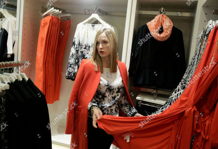 """Stock Picture of Lisa Axelson Creative director for Ann Taylor, Lisa Axelson discusses fashion at Ann Taylor's renovated location in The Westchester shopping mall in White Plains, N.Y. She pointed out the styles that she believes are the cornerstone of a woman's wardrobe in 2013. The store is set up like a closet, without a specific """"suits section"""" or all the denim tucked in the back corner"""