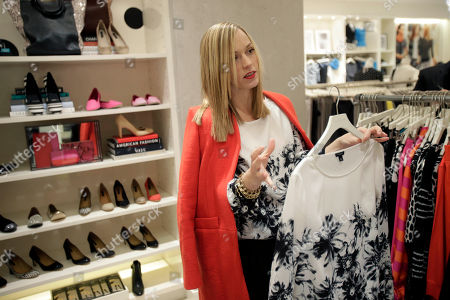 """Lisa Axelson Creative director for Ann Taylor, Lisa Axelson discusses fashion at Ann Taylor's renovated location in The Westchester shopping mall in White Plains, N.Y. She pointed out the styles that she believes are the cornerstone of a woman's wardrobe in 2013. The store is set up like a closet, without a specific """"suits section"""" or all the denim tucked in the back corner"""