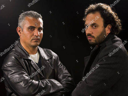 """Emad Burnat, Guy Davidi Documentary film co-directors Palestinian Emad Burnat, left, and Israeli Guy Davidi pose for a photo after an interview in Los Angeles, . Their 2011 documentary film, """"5 Broken Cameras,"""" is nominated for an Oscar in the best Documentary Feature category"""