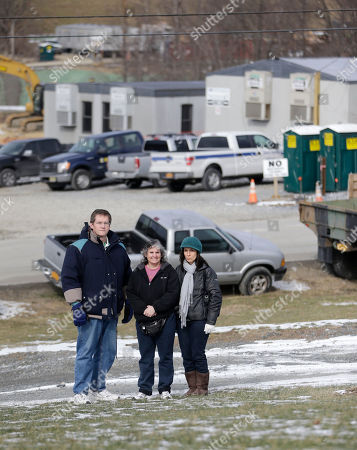 Stock Picture of Shawn Cahill, Karen Gartenberg, Edna Rodriguez Minisink residents, from left, Shawn Cahill, Karen Gartenberg and Edna Rodriguez stand on the lawn of a property across the road from the construction site for a natural gas compressor station in Minisink, N.Y. Residents of Minisink want federal regulators to reconsider their proposal to put the industrial facility on a more remote company-owned site that's farther from homes and farms