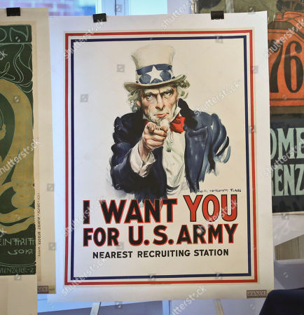 """James Montgomery Flagg's """"I want You For The U.S. Army"""" on display during an exhibit of Hans Sachs' collection of rare posters at the Bohemian National Hall in New York. In 1938 the Nazis seized 1,200 posters belonging to Sachs and it took his grandson, Peter Sachs, several years to get what was left of the collection back. Posters from the collection went up on the block at Guernsey's Auction House in New York, where they brought in approximately $2.5 million"""