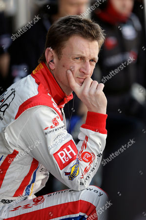 Allan McNish Driver Allan McNish, of Scotland, watches cars on the track from his pit stall during practice for the Rolex 24 hour auto race at Daytona International Speedway, in Daytona Beach, Fla