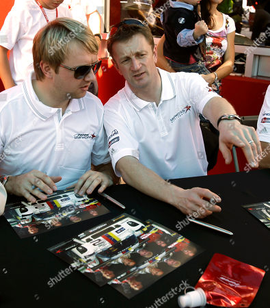 Ryan Dalziel, Allan McNish Ryan Dalziel, left, and Allan McNish, both of Scotland, sign autographs for fans prior to the Grand-Am Series Rolex 24 hour auto race at Daytona International Speedway, in Daytona Beach, Fla