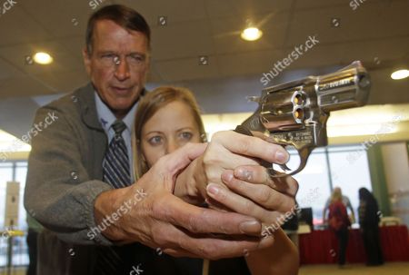 Cori Sorensen, a fourth grade teacher from Highland Elementary School in Highland, Utah, receives firearms training with a .357 magnum from personal defense instructor Jim McCarthy in West Valley City, Utah, where teachers and administrators are allowed to bring guns to school. Lawmakers in many Republican-led states proposed arming school personnel with guns following a mass shooting at a Connecticut school, yet four months later the quest has stalled in many traditionally gun-friendly states