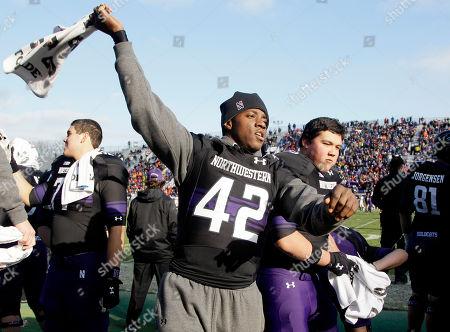 Joseph Jones Northwestern linebacker Joseph Jones (42) celebrates as he watches teammates play during the second half of an NCAA college football game against Illinois in Evanston, Ill., . Northwestern won 50-14